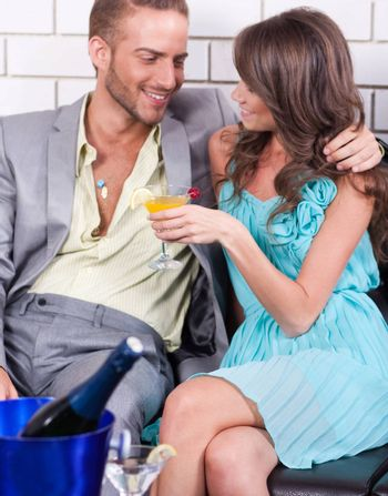 Amorous couple sharing fun moments together at restaurant.
