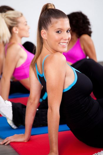 Group of gym people in an aerobics class, working out..