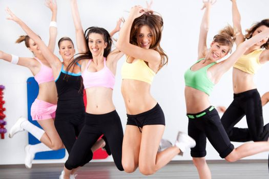 Enthusiastic group of women having fun in aerobics class.