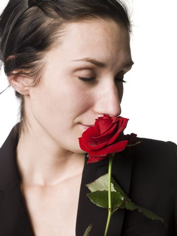 Woman smell a rose