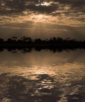 Morning sun rays through clouds in Samburu Reserve, Kenya