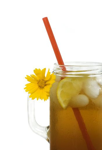 Refreshing iced tea with lemon wedge, served southern style in a jelly jar