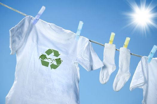 T-shirt with recycle logo drying on clothesline on a hot summer day