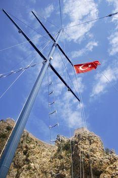 Turkey's flag on mast of pleasure boat.