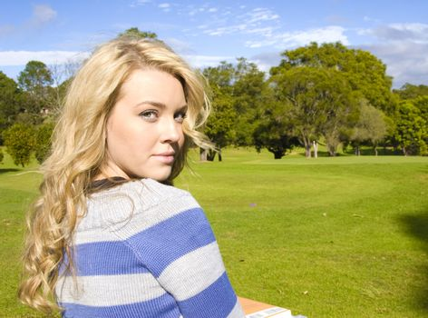 girl at the golf coarse