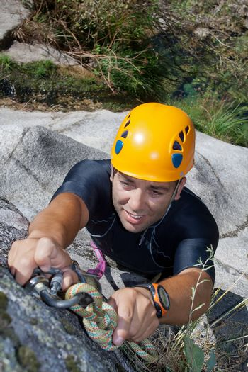 Men prepering to rappeling on waterfall