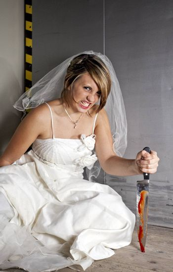 angry young bride with a bloody knife in an elevator