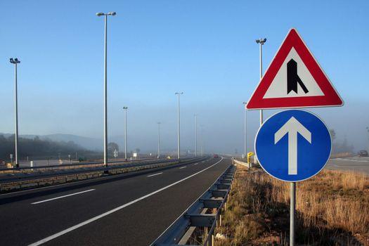 signs in foggy motorway