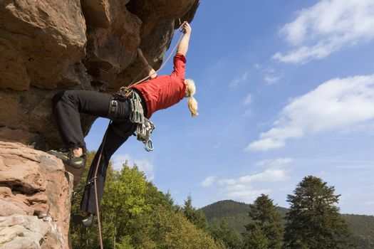 Rock climber Charlotte Frank at the Windstein - Vosges - France.
