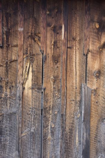 weathered wood backround - old barn wall with a different exposure to elements