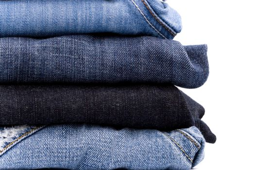stack of blue jeans