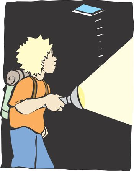 A boy with a flash light explores a dark cave.