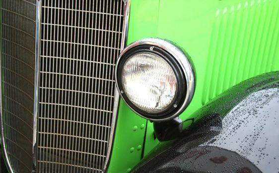 green vintage car close up view abstract