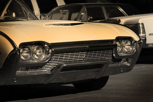 Vintage muscle car in black sepia color tone