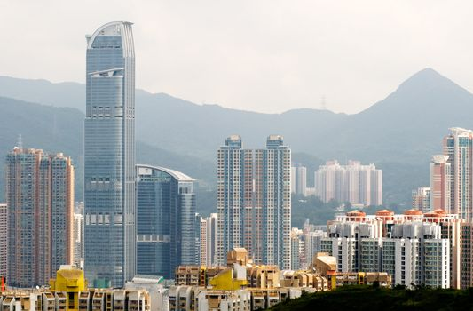 Cityscape of tall apartments and houses