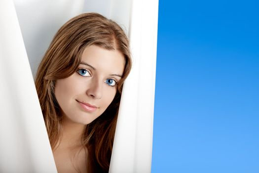 Portrait of Fresh and Beautiful young woman over a blue background