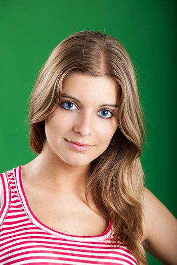 Close-up portrait of a Fresh and Beautiful young woman, isolated on green background