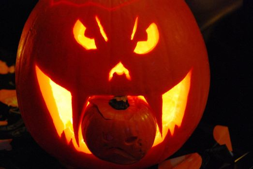 A close up for a carved pumpkin for Halloween