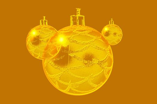 Abstract design concept of three gold ornaments.