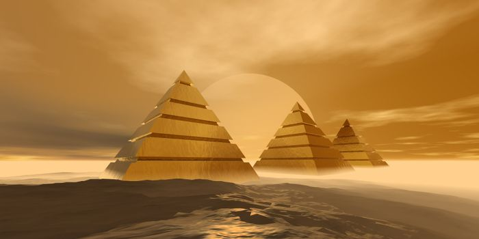 Three imposing golden pyramids in the desert.
