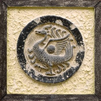 Chinese religious stone carving of peafowl