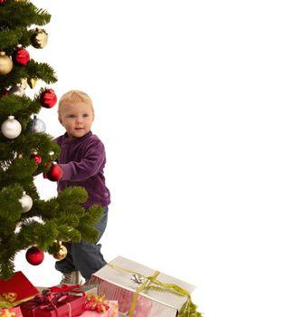 Christmas - Child putting decorations on tree