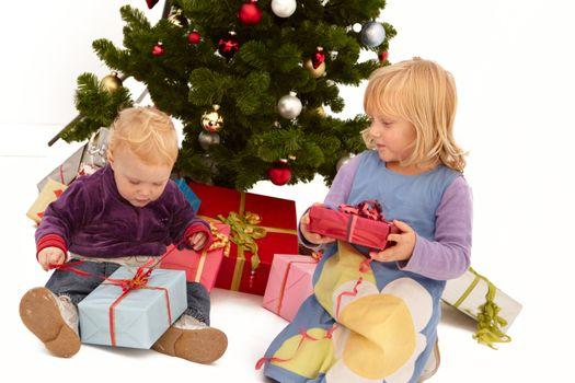 Christmas - Kids opening presents under tree