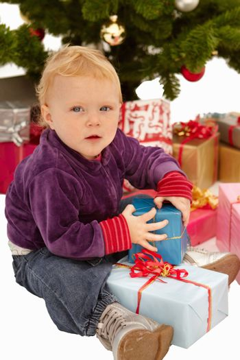Christmas - Child caught opening gifts under tree