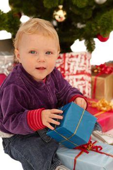 Christmas - child opening x-mas gifts
