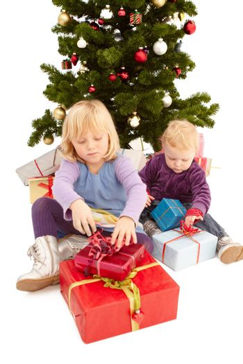Christmas - Cute young girls opening their presents