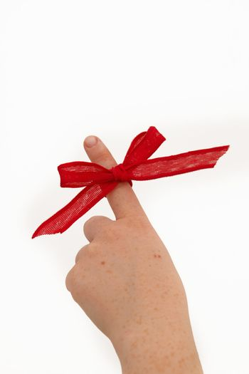 Pointing a ribbon on a finger
