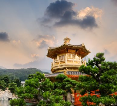 Golden buddhism tower with sky and light