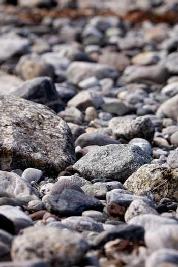 A coastal rock background with round water washed rocks