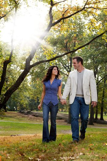 A happy couple walking in the park - looking at each other