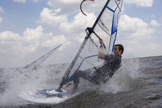 Up close view of a windsurfer at high speed