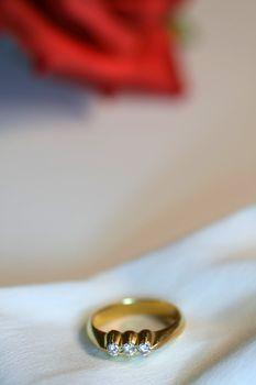 Diamond wedding ring on satin cloth background