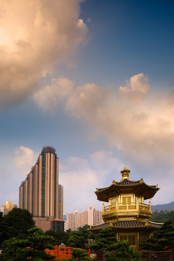 Golden Buddhism tower with modern tall buildings