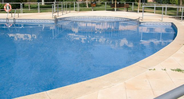 swimming pool invite to relax in the summer