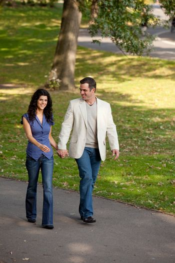 A happy couple walking in the park