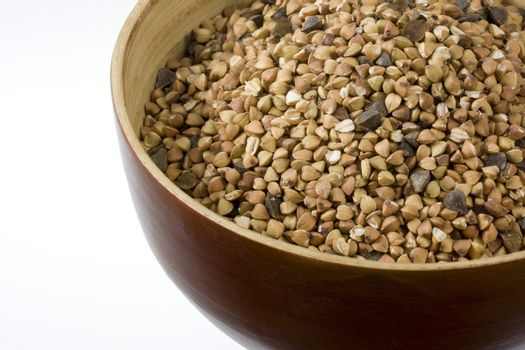 a wooden bowl of buckwheat (kasha), toasted whole grain, white copy space
