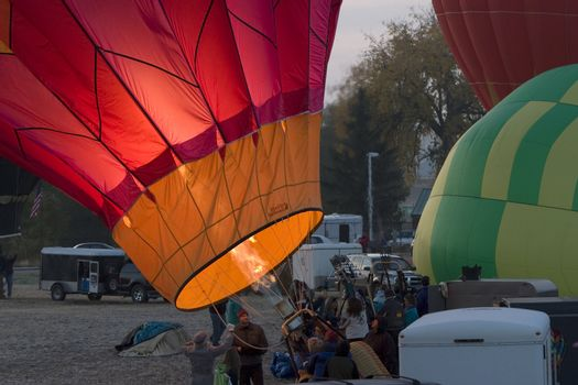inflating hot air balloon before sunrise at Greeley, Colorado, festival, October 2007