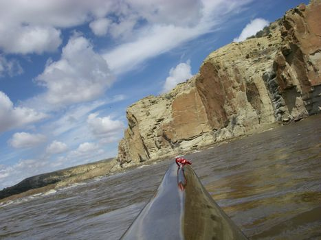view from a bow of racing kayak on the North Platte River in Wyoming