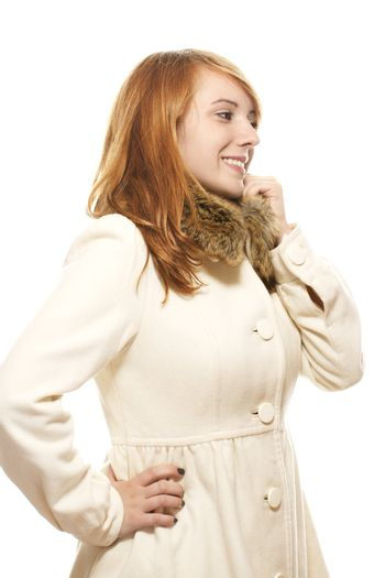young smiling woman in fawn winter coat