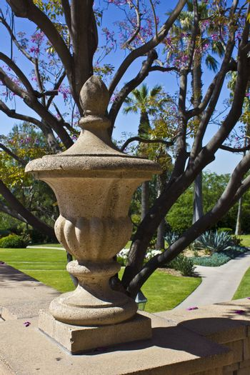 An image of a stone vessel outdoors in a garden.