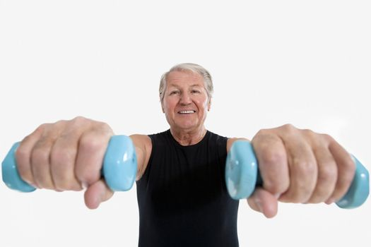 wide angle view of senior man doing weight lifting