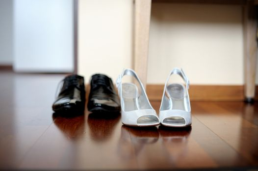 Elegant bride's and groom's shoes on the parquet