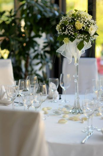 Table set for a festive party or dinner with a yellow rose