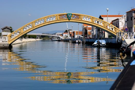 Old yellow bridge accross the small channel