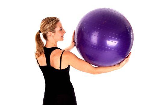 Young woman doing yoga ball exercises isoalted