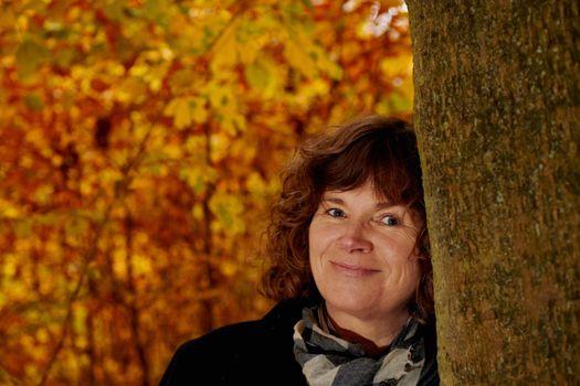 Fall - mugshot of mature woman looking at you
